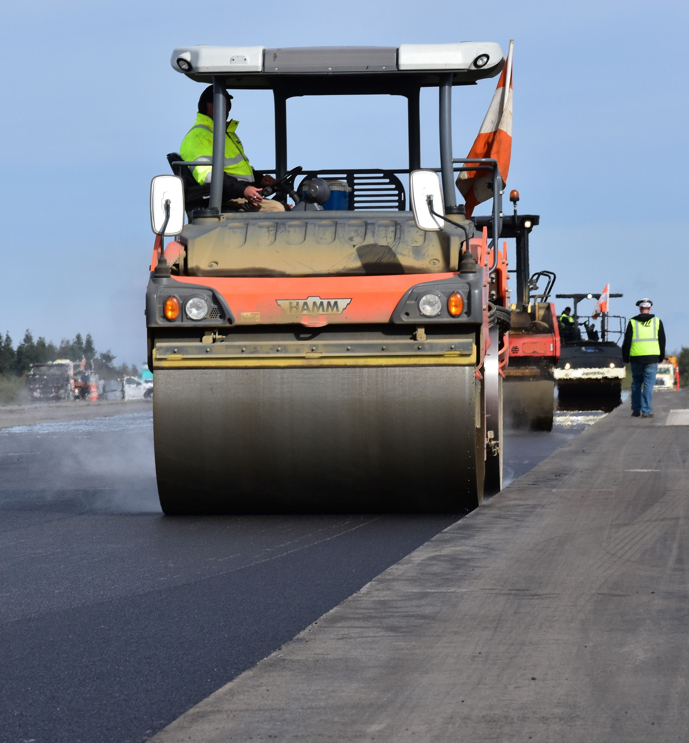 Roller compresses asphalt on runway October 3, 2018
