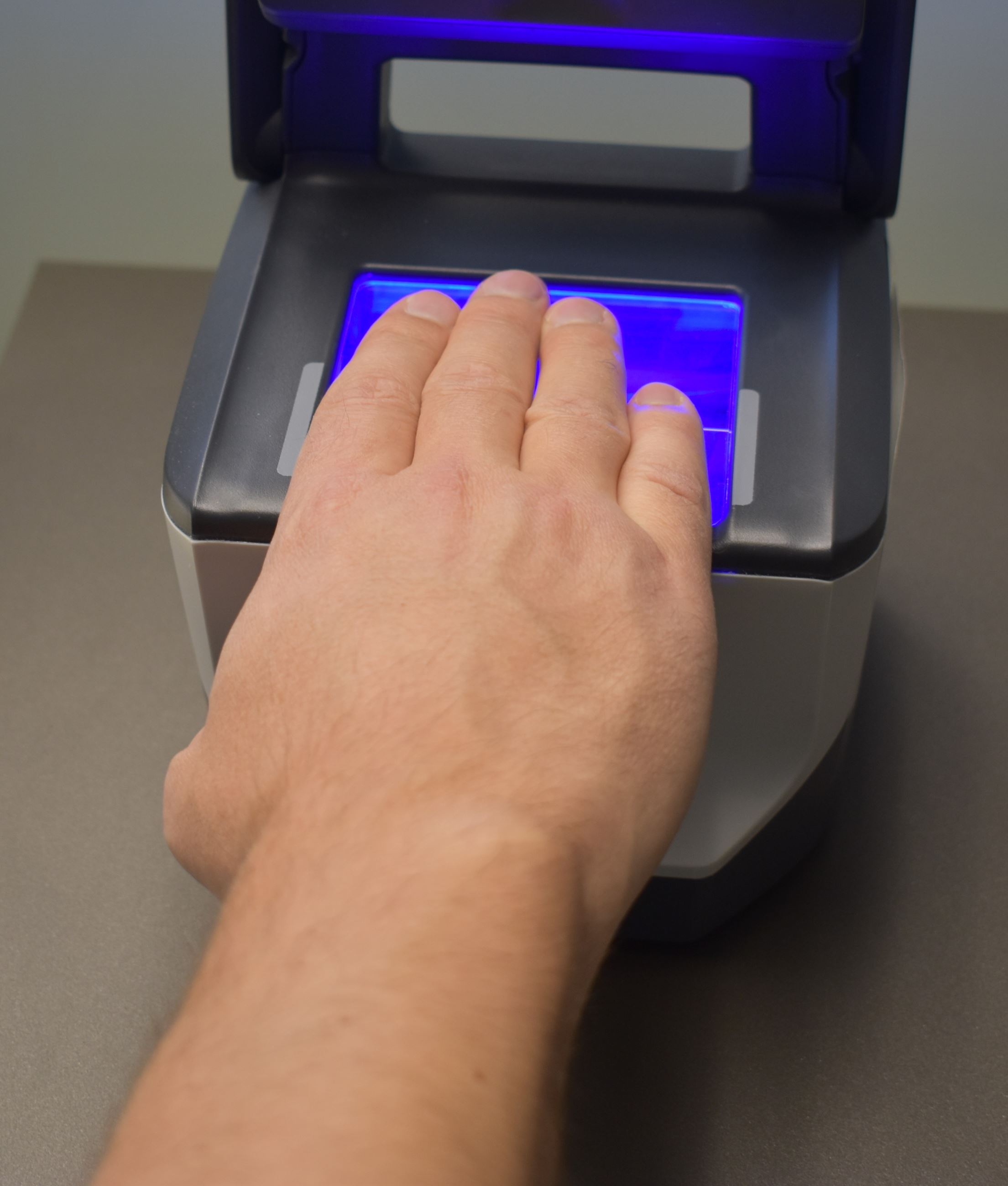 Hand on fingerprint machine